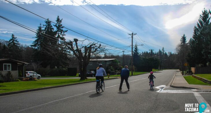 a family on a bike ride in fircrest wa
